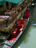 Fancy Gondola Parked in a Canal Next to a Restaurant  Venice  Italy