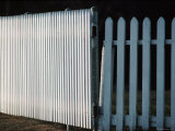 Detail of a White Picket Fence