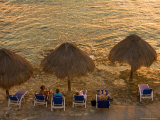 Guests Relax at Sunset Along the Water at the Caribe Blu Hotel  Cozumel  Mexico