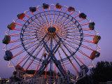 People Ride an Upsidedown Ferris Wheel in Wildwood  New Jersey