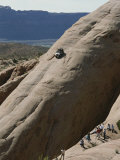 Jeep Drives Down a Slick Rock Formation Called Lion's Back  Utah