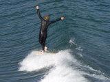 Man Surfs a Longboard at Refugio Point  California