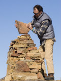 Man Builds a Rock Cairn on Topatopa Bluff in the Sespe Wilderness  California