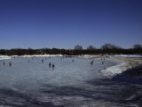 People Ice Skate on a Frozen Lake in Wisconsin