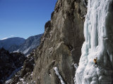 Male Ice Climbing in the Clark&#39;s Fork Canyon  Wyoming