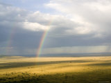 Rainbows Form over the Serengeti Plains  Tanzania