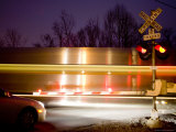 Nighttime Warning Lights Warn of a Blurred Passing Train  Silver Spring  Maryland