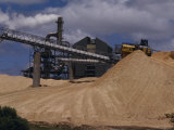 Logging Wood Chip Mill and a Tractor Atop a Vast Mound of Pulp  Australia