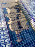 Reflection of the Mission San Buenaventura in Pool with Spanish Tiles  California