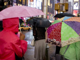 Pedestrians with Umbrella in Times Square on a Rainy Afternoon