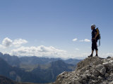 Rock Climber Stands on a Mountain Summit in the Dolomites  Italy