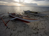 Outrigger Fishing Boats Pulled Up on the Beach on Malapascua Island  Philippines
