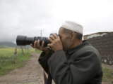 Muslim Rural Resident Looks Through a Camera  Qinghai  China