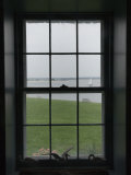 Looking Through the Window of Historic Home to a Sailboat on the Sound  Stonington  Connecticut