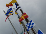 Nautical Flags Hanging from the Wooden Mast of a Sailing Ship  Mystic  Connecticut