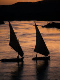 Sunset on the Nile River with Silhouetted Boats in Egypt