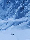 Three People Skiing Up the Kahiltna Glacier on Denali  Alaska