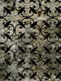 Ornate Iron Gate in Front of a Brick Wall  Asolo  Italy