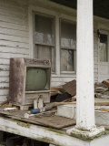 Ruined Old Television and Debris on Porch of an Abandoned House