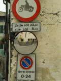 Road Signs and Wide Angle Mirror Along an Italian Road  Asolo  Italy