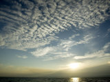 Setting Sun over the Sea with Cloud Filled Sky  Belize