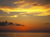 Sunset on Horizon of Caribbean Sky with Clouds