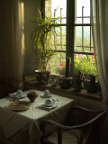 Table is Set for Breakfast near a Window Looking Out on Tuscan Hills  Tuscany  Italy