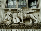 Statue of Winged Lion of St Marks and Doge Adorns Building in Venice  Italy
