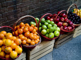 Six Baskets of Assorted Fresh Fruit for Sale at a Siena Market  Tuscany  Italy