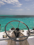Steering Wheel of Boat and View of Turquoise Horizon  Ambergris Caye  Belize