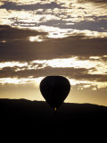 The Silhouette of a Hot Air Balloon and Jet Flame at Dawn  Australia