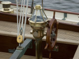 Ship&#39;s Wheel and Compass at the Helm of a Wooden Sailboat  Mystic  Connecticut