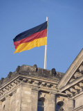 The German Flag Flies High above the New Reichstag in Berlin  Germany