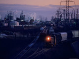Trains Surrounded by Industrial Plants