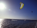 Three Kite Surfers on a Windy Summer Day Race Across a Bay  Australia