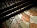 Shadows of an Iron Fence Fall on the Marble Floor of the Frari Church  Venice  Italy