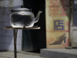 Teapot Warms on a Solar Stove in a Street  Qinghai  China