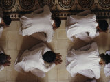 Vietnamese Men Bow Down During Worship at the Cao Dai Great Temple