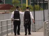 Two Hasidic Jews Walking Along the Boardwalk  Brooklyn  New York