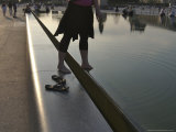 Young Woman Steps into the Reflecting Pool at the Louvre-Model Released  Paris  France