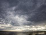 Sun Streams Through Gathering Storm Clouds on North Carolina Coast