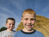 Two Young Kids by a Haybale in Greenleaf  Kansas
