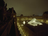 The Pyramid Glows at Night in the Cour Napoleon III at the Louvre  France