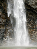 Waterfall Tumbles against Fractured Metamorphic Rock  Alaska