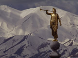 The Gilded Statue of the Angel Moroni against the Oquirrh Mountains  Utah