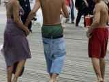 Three Teenagers Walking on the Boardwalk at Coney Island  Brooklyn  New York