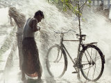 Two Men Are Hosed Down for Purification at the Water Throwing Festival in Burma