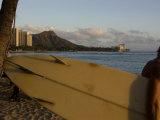 Surfer Heads to the Water in Honolulu  Waikiki Beach  Hawaii