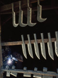 Tools Hang near a Metalworker at Work in a Saddle Maker&#39;s Shop
