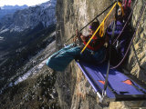 Woman Hanging Out on Her Bivouac Ledge after a Day of Climbing